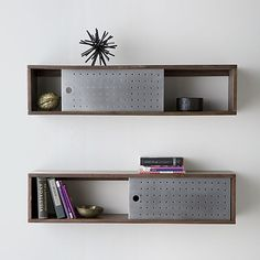 Dark mango wood shelf slides single perforated aluminum door to expose or enclose knick knacks and smalls. Top also serves as display shelf. Float in entry, kitchen, even bedside as nightstand.