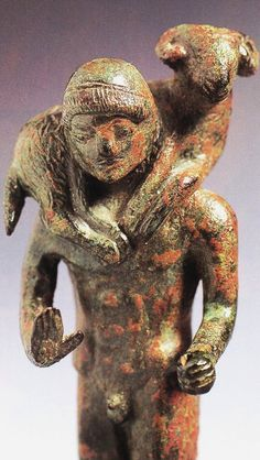 Creek bronze statue of a calf (ram) bearer.                 Ca 5th century BC, Greek and Magna Graecia. Metaponto museum