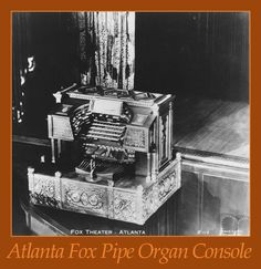 """THE ATLANTA FOX THEATRE ORGAN CONSOLE. An old publicity photo showing the console raised in the orchestra pit to """"Solo Level"""" at which the organists would play their solo at the 8-o-clock show. The organists would rise out of the pit bathed in a spotlight while playing their opening """"console raiser"""" tune, with the stage curtain closed, it and the house probably changing colours according to the tune. Many patrons choose their theatre depending on who the famous organist was."""