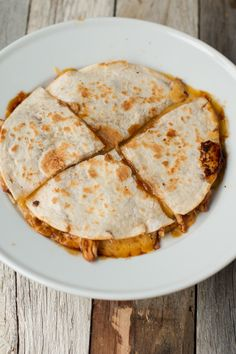 Don't knock it until you try it. There's something so delicious about teriyaki chicken stuffed in a gooey, cheesy quesadilla. Plus the kids love it, Win!! ohsweetbasil.com