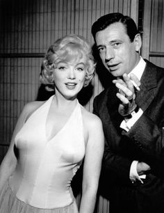 Marilyn Monroe and Yves Montand photographed at a press conference for Let's Make Love, 1960. S)