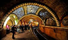 Stunning NYC Subway Station Hidden in Plain Sight // Simply stay on the 6 train instead of getting off at Brooklyn Bridge, the last stop. The train actually makes a turnaround through City Hall station as it starts its return trip uptown.