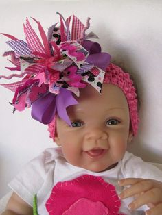 Hot pink and purple minnie mouse hairbow by FiestaKidsBoutique on etsy... it has cupcakes and lollipops!!