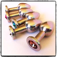 Lady Kink - Medium Jewel Plug R This Medium Jewel Plug is crafted from medical grade stainless steel with a matt finish and a cut glass jewel added at the base for extra bling. Cut Glass, Plugs, Bling, Medical, Stainless Steel, Base, Jewels, Jewel, Corks