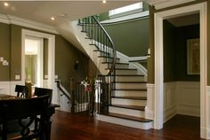 curved staircase and open basement