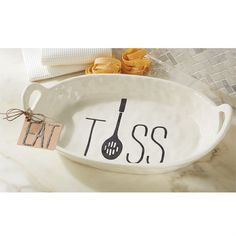 Mottled ceramic bowl features stamped 'TOSS' sentiment with spoon graphic. Arrives with kraft tag featuring metal 'EAT' message. #MudPieGift