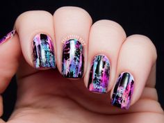 Get grungy and try out my distressed manicure! Add swipes of color to a white base by wiping almost all of the polish off of the brush and lightly dragging it down the length of your nail. Finish off the look with black for nail art that pops