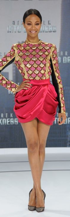 Who made  Zoe Saldanas sequin top, pink skirt, and pumps that she wore in Berlin on April 29, 2013?