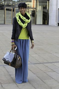 Blogger Kee Siler wears a BCBG coat, J.Crew sweater, Anthropologie pants, and Louis Vuitton bag.