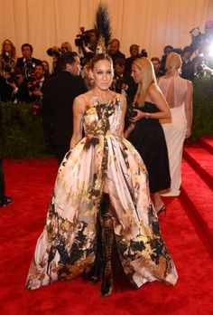 Sarah Jessica Parker won rave reviews for her interpretation of the 2013 Met Gala's punk theme when she hit the red carpet in this Giles Deacon gown that she topped off with a Mohawk-style headpiece by Philip Treacy. - Kevin Mazur/WireImage