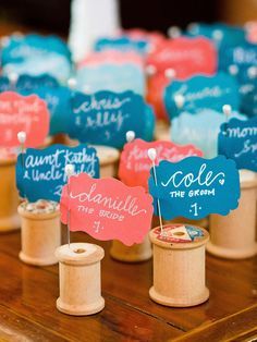 Tag your guests' names with cute thread spools for DIY wedding escort cards. Ideal for brides who crave handmade rustic or vintage details!