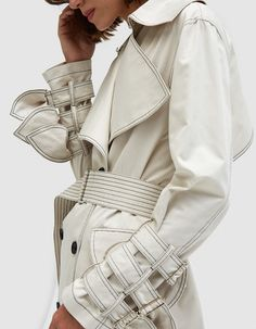 Stylized trench coat from KIMHĒKIM in Ivory. Exaggerated peak lapel collar with hook closure. Back storm flap. Belt loops at waist. Fashion Now, Suit Fashion, Fashion Details, Fashion Outfits, Womens Fashion, Fashion Design, Sleeve Designs, Minimal Fashion, Pretty Outfits