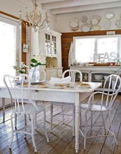 Old white table and kitchen--very farmhouse-y feeling. Cozy