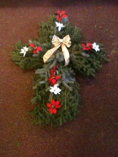 I think of my Mom every day and wish she were still with me.  Every Christmas I always made a home-made gift for her.  I will always continue to do so.  This years gift was made with fresh pine, blue spruce, chicken wire, flowers, a bow and most importantly LOVE.