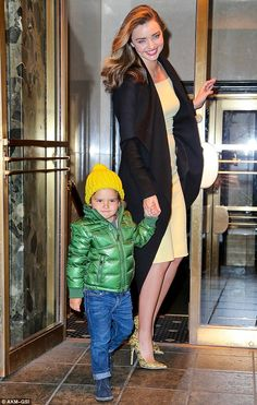 Date night: Miranda Kerr and son Flynn were all smiles as they headed to dinner on Wednesday night