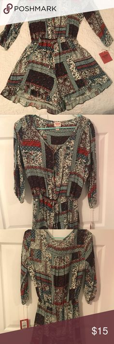 Target romper This is a summer romper with 3/4 sleeves. It is cinched at the waist which can be tightened. Mossimo Supply Co. Other
