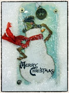 Tim Holtz - awesome use of reused packaging on a tag