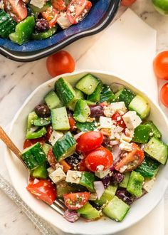 This Greek Salad is a classic salad of cucumbers and tomatoes loaded with feta cheese and olives. Perfect as a side dish or as a meal on its own.