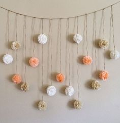 Peach and Creams Tissue Paper Flowers Wedding Garland / http://www.himisspuff.com/pom-poms-decor-ideas-for-your-wedding/2/