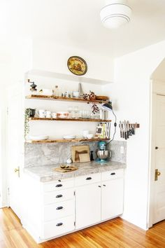 Kitchen Makeover: White cabinets, and floating, live-edge wood shelves