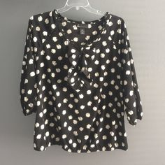 Lane Bryant Polka Dot Bow Top 100% polyester. Worn twice. 3/4 sleeves. Neckline has a small ruffle hem. Lane Bryant Tops Blouses