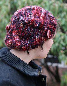 This hat, designed for Knitcrate, is worked in a luxuriously soft bulky weight yarn, features a 1920's silouhette. The brim is worked sideways, closing with a button tab, and one section is worked in seed stitch to add a little texture.