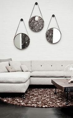 Love the grouping of three smaller mirrors to fill the space above a sectional sofa.