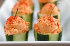 Red pepper hummus in cucumber cups! These would be great topped with crumbled feta. I think I like this idea better than the other cucumber cups. Yummy Appetizers, Appetizers For Party, Appetizer Recipes, Party Nibbles, Tapas Party, Raw Food Recipes, Healthy Recipes, Cucumber Cups, Red Pepper Hummus