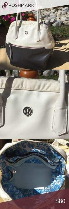 lululemon gym bag Bowling style bag. Lots of hidden pockets for phone, and padded laptop storage space. Great weekend bag can fit your life all in one bag. 18 inches wide, see picture for height. Was used gently. lululemon athletica Bags Totes