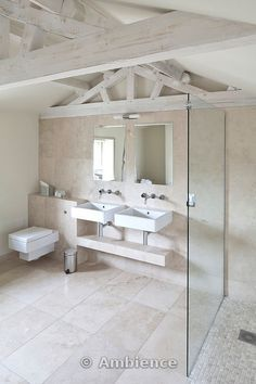 beautiful contemporary country bathroom, whitewashed beams and travertine marble tiles combined with modern bathroom fittings
