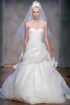 Fall 2011 Monique Lhuillier Bellflower wedding dress - ivory floral textured silk organza strapless cross-over draped bodice gown with full hand tufted skirt