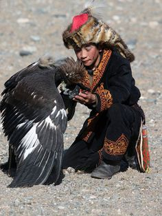 Remeber: Pants' Leg's detail Asian Man and eagle  The Mongolians and Falconry go…