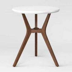 Complete your modern-styled breakfast nook or coffee corner with the Emmond Mid-Century Round Bistro Table from Project 62™. This two-tone table brings together the clean, angular lines and simple shapes that are a hallmark of mid-century style. Complete the entire look by pairing it with complementing chairs and placing a small accent rug underneath.<br><br>1962 was a big year. Modernist design hit its peak and moved into homes across the country. And in Minnesota, Targe...