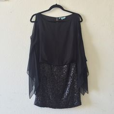 Marciano Black Sequin Chiffon Dress Black Chiffon dress with sequin bottom. Sleeves are slit open from shoulders so shoulders are bare. Slit in back. Exposed zipper in back on sequin skirt. In perfect condition. No damages. 😊Never been worn. No size tag or care tag, but there is a designer tag. No missing sequins. Gorgeous party 🎉or holiday🍾 dress! No trades😊 Guess by Marciano Dresses Prom