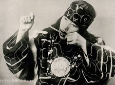 Ainu woman playing the Mukkuri, Hokkaido, ca.1920. Mukkuri is a traditional Japanese plucked bamboo idiophone, similar to a jaw harp.