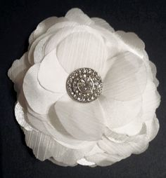 My DIY Wedding Hair Clip! :  .....maybe take dollar store petals and rhinestone button for bouquet?