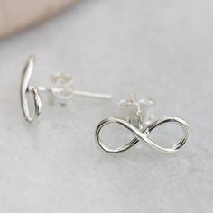 Molly & Pearl Sterling Silver Infinity Earrings ($19) ❤ liked on Polyvore featuring jewelry, earrings, white pearl earrings, infinity earrings, sterling silver earrings, pearl jewelry and pearl jewellery