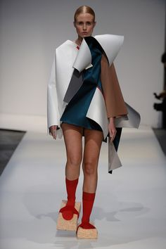 London College of Fashion show. No, no the runway!. I said: Sponge clean the billboard, not to wear them.