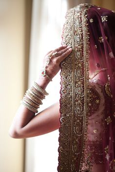 A beautiful Indian bride in mauve lehenga! Do you like the embellished border of her dupatta?