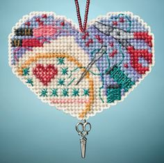 Mill Hill Love Stitching - Beaded Cross Stitch Kit. Kit Includes: Beads, charms, perforated paper, needles, floss, chart, and instructions. Can be used as an or