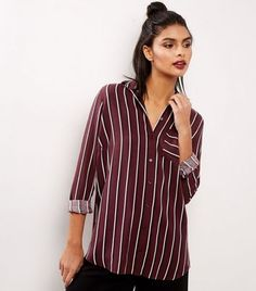 """Bring bold prints into your wardrobe with this striped shirt. Pair with black culottes and strappy heels to complement.- Collared neck- Single pocket front- Button up front- All over stripe print- Simple long sleeves- Button cuffs- Casual fit that is true to size- Marianna is 5'9""""/175cm and wears UK 10/EU 38/US 6"""