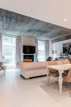 homeadverts:  Modern, minimalistic living room in Quebec | Homeadverts Award winning Unity II Building located in the heart of Montreal just steps from the downtown core & the Old Port.