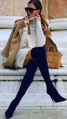 a white sweater dress, black suede tall boots, a camel coat and an ocher bag for a chic look