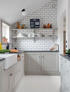 Many townhouses and apartments have compact kitchens that are small and claustrophobic. But there are designer tricks that you can apply to make even the smallest kitchen feel larger than it is.