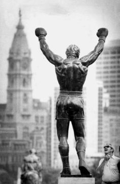 Statue of the famed Rocky Balboa character from the 'Rocky' film series, shown here in its much-disputed 'top-of-the-steps' perch at the Philadelphia Art Museum, looking out on center city.
