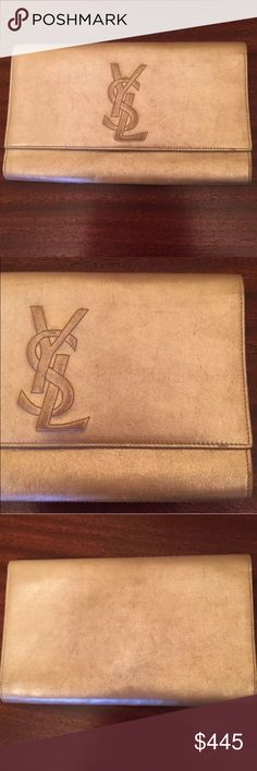 "YSL Authentic Clutch Pre-owned YSL clutch. Rare hard to find clutch. They no longer make these but definitely a classic. Has few signs of wear but still a beautiful elegant clutch that matches with almost everything! 100% Authentic Clutch. Measurements are 6.75""X11"" Yves Saint Laurent Bags Clutches & Wristlets"