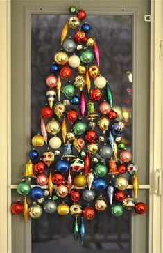 "Ornament Tree....The ""tree"" is made by hooking ornaments thru the screen material on the back door"