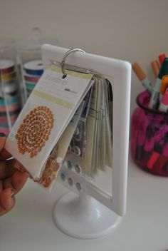 use $1 IKEA frames to store your bling and enamel dots - more details and photos on the blog!