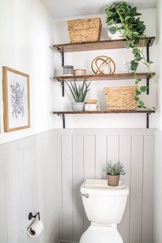 A small powder room gets a bright and fresh California casual decor style with budget decorating finds and simple DIY-friendly shiplap.