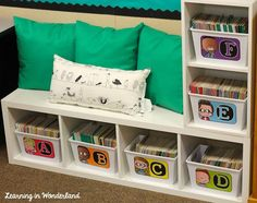 Classroom Tour I love the idea of using a bookshelf and turning it on it's side, making it a seat as well! First Grade Classroom, Classroom Setting, Classroom Design, School Classroom, Classroom Themes, Classroom Libraries, Future Classroom, Classroom Window Decorations, Classroom Library Labels